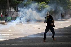 April 26, 2017 - Caracas, Venezuela - Opposition activists clash with riot police during a protest against President Nicolas Maduro in Caracas on April 26, 2017..manifestants (Credit Image: © Panoramic via ZUMA Press)