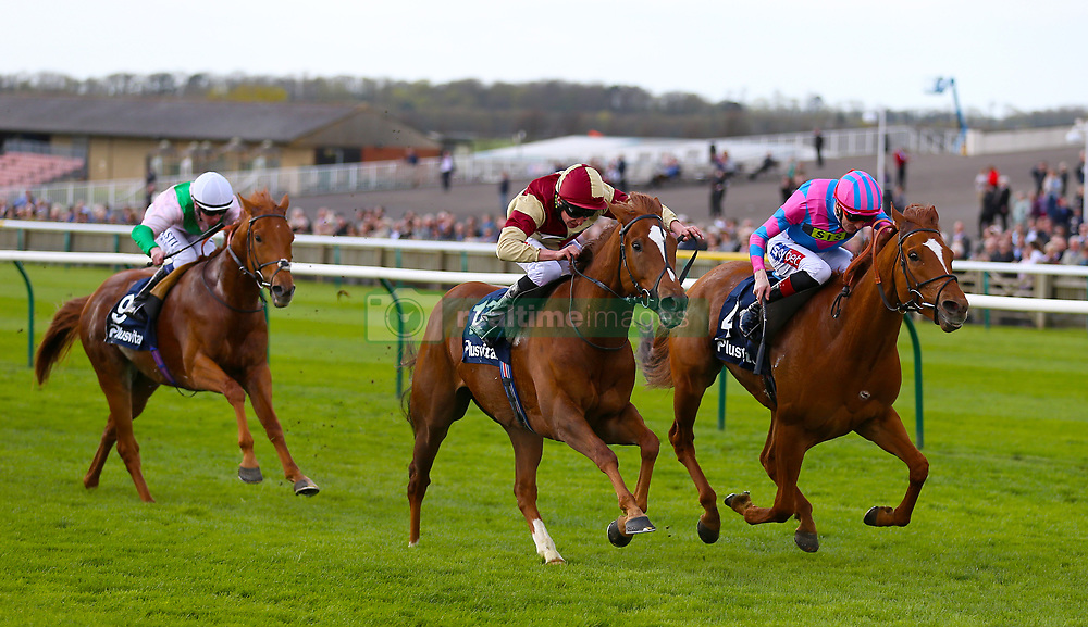 Examiner ridden by jockey Fran Berry (right) beats Red Tea ridden by jockey Luke Morris (centre) in the Plusvital Energene-Q10 Handicap during day one of The Bet365 Craven Meeting at Newmarket Racecourse, Newmarket.