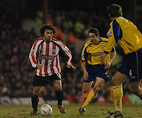 Photo. Leigh Quinnell, Digitalsport<br />   Brentford v Southampton FA cup. 01/03/2005.Brentfords Deon Burton can't find a way past Southamptons paul Telfer and Andreas Jakobsson