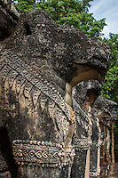 Wat Chang Rop is of Ceylonese style and its base is adorned with 68 elephants along with traces of demons and female dancers' figures remaining. Steep staircases lead up to a platform, where the remains of a Chedi still stands. In the front of the temple is a large pool made of laterite overgrown with large trees.