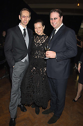 Left to right, NICK KNIGHT, his wife CHARLOTTE and JO THORNTON at the Veuve Clicquot Widow Series launch party hosted by Nick Knight and Jo Thornton MD Moet Hennessy UK held at The College, Central St.Martins, 12-42 Southampton Row, London on 29th October 2015.