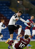 Football - 2020 / 2021 Premier League - Burnley vs. Fulham<br /> <br /> Joachim Andersen of Fulham appears to stamp on Ashley Barnes of Burnley in the Fulham area but no foul is given, at Turf Moor.<br /> <br /> <br /> COLORSPORT/ALAN MARTIN