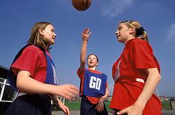 Netball team practising at secondary school; UK