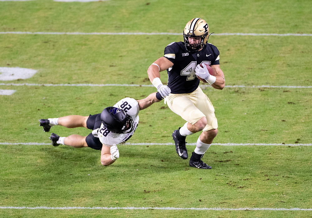 November 14, 2020:  Purdue running back Zander Horvath (40) runs with the ball as Northwestern linebacker Chris Bergin (28) attempts to make the tackle during NCAA football game action between the Northwestern Wildcats and the Purdue Boilermakers at Ross-Ade Stadium in West Lafayette, Indiana. Northwestern defeated Purdue 27-20.  John Mersits/CSM.