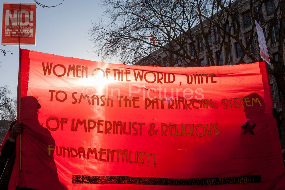 Women protesters march through central London as part of an international campaign on the first full day of Donald Trumps presidency, on 21st January 2017, in London, England. They marched from the US embassy in Mayfair, to Trafalgar Square for a rally, held in solidarity with a march in Washington and other cities around the world. Organisers say it highlighted womens rights, which they perceive to be under threat from the new US administration. London organisers announced on stage that between 80,000 and 100,000 people - which included both men and women - had taken part in the rally.