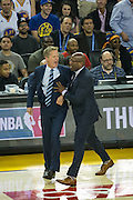 Golden State Warriors head coach Steve Kerr reacts to a hard hit by Oklahoma City Thunder center Steven Adams (12) on Golden State Warriors guard Stephen Curry (30) at Oracle Arena in Oakland, Calif., on November 3, 2016. (Stan Olszewski/Special to S.F. Examiner)