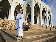 28 JULY 2014 - KHLONG HAE, SONGKHLA, THAILAND:  A man waits for Eid services to start at Songkhla Central Mosque. Eid al-Fitr is also called Feast of Breaking the Fast, the Sugar Feast, Bayram (Bajram), the Sweet Festival and the Lesser Eid, is an important Muslim holiday that marks the end of Ramadan, the Islamic holy month of fasting.  PHOTO BY JACK KURTZ