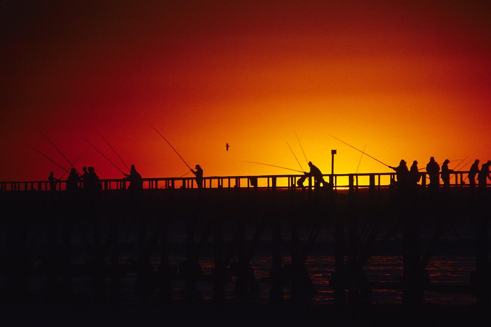 Fishing pier near Swakopmund in Namibia at sunset.