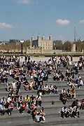 Crowds of office workers and tourists at lunchtime sit in the Scoop on the South Bank seen in front of the Tower of London during hot and sunny weather on April 20, 2018 in London, England. Yesterday the United Kingdom experienced the hottest day in April since 1949, with temperatures reaching 27.9C 82.2F in London.