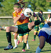 Robin Zielinski/Sun-News<br /> Mayfield High School goalie Teagan Moore makes an athletic effort while defending her goal before Las Cruces HIgh School forward Alaniz Salas can take advantage on Tuesday at the Field of Dreams Soccer Complex.
