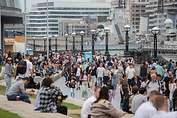 © Licensed to London News Pictures. 29/05/2021. London, UK. Members of the public enjoy the sunny weather near Tower Bridge, central London. Photo credit: Marcin Nowak/LNP
