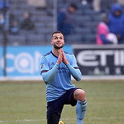 NEW YORK, NEW YORK - March 18: Maxime Chanot #4 of New York City FC says a pray at the end of the game during the New York City FC Vs Montreal Impact regular season MLS game at Yankee Stadium on March 18, 2017 in New York City. (Photo by Tim Clayton/Corbis via Getty Images)