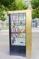 Public Bookcase where people can take and share books on street in Dusseldorf in Germany