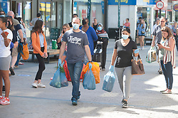 ©Licensed to London News Pictures 15/06/2020<br /> Bromley, UK. Shoppers wearing masks carrying their bags in Bromley high street, Bromley, South East London. Shops around the UK have reopened their doors today after three months on Coronavirus lockdown. Photo credit: Grant Falvey/LNP