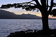 The sun set behind Carrauntoohill Mountain overlooking Lough Lein, Killarney.<br /> Picture by Don MacMonagle