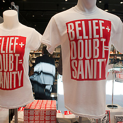 """Barbara Kruger t-shirts depicting the words """"Belief + Doubt = Sanity,"""" are sold at the Hirshhorn Museum gift shop in Washington, DC."""