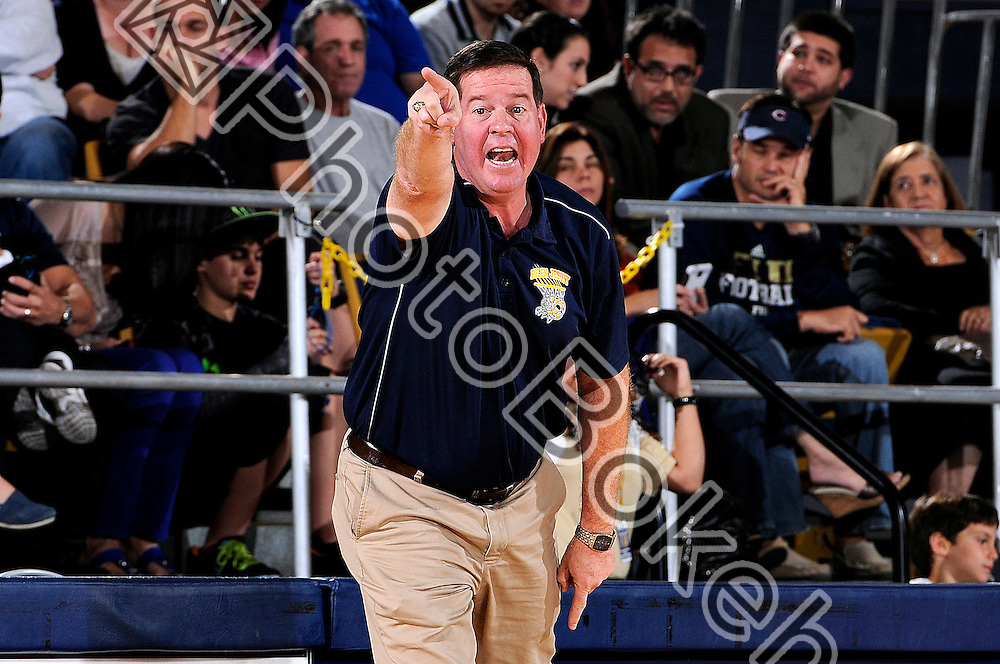 2012 January 13 - Belen's head coach Jose Roca directing his team from the sidelines. Belen Jesuit Wolverines variety basketball fell to the Columbus Explorers, 58-54, at the U.S. Century Bank Arena, Miami, Florida. (Photo by: www.photobokeh.com / Alex J. Hernandez) 1/250 f/5.6 ISO200 300mm