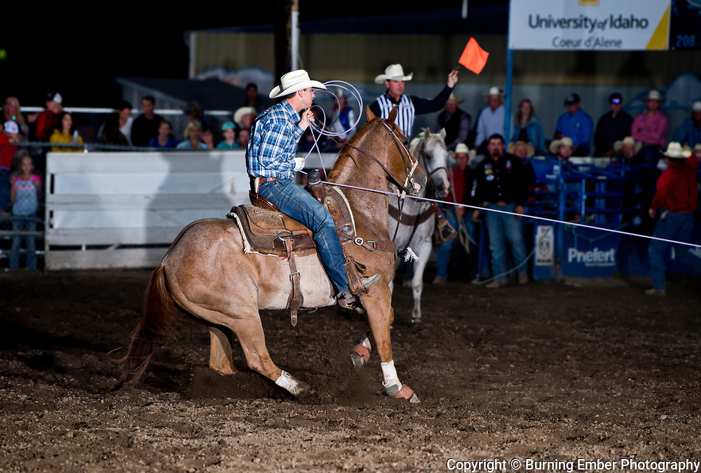 Will Woodfin in the team roping event during the 2nd perf at the Gem State Stampede August 25th, 2018 2nd perf in Couer D'Alene ID.  Photo by Josh Homer/Burning Ember Photography.  Photo credit must be given on all uses.