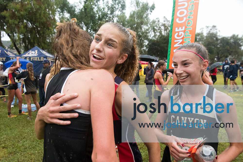 Canyon's Emma Hadley is hugged by Yorba Linda's Siena Palicke after the Girls Varsity Sweepstakes race at theOrange County Cross Country Championships  at Oak Canyon Park on Saturday, October 13, 2018 in the unincorporated community of Silverado, Calif. (Photo by Josh Barber, Contributing Photographer)