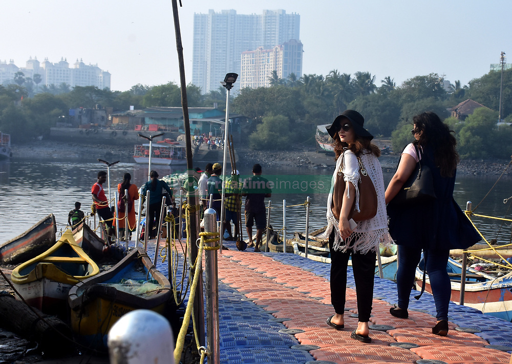 November 21, 2018 - Mumbai, India - (EXCLUSIVE) Actress Elli Avram in black hat seen at the Versova Jetty in Mumbai..Elli travelled by a jetty to Madh Island, where most of the shootings happened. (Credit Image: © Azhar Khan/SOPA Images via ZUMA Wire)
