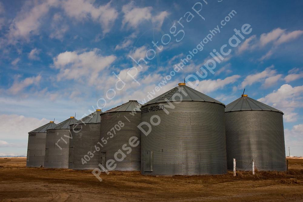 Grain Bins in front of a cloudy blue sky...©2009, Sean Phillips.http://www.Sean-Phillips.com