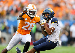 Sep 1, 2018; Charlotte, NC, USA; West Virginia Mountaineers wide receiver Marcus Simms (8) attempts to catch a pass during the third quarter against the Tennessee Volunteers at Bank of America Stadium. Mandatory Credit: Ben Queen-USA TODAY Sports