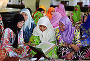 Girls and women studying the Koran at the madrassa at the Jame'asr Hassanal Bolkiah Mosque in Brunei Darussalam