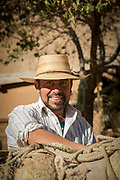 Portrait of farmer in straw hat smiling, Elqui Valley, Chile