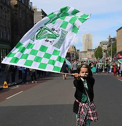 Hibernian Scottish Cup Open Top Bus Edinburgh 14 May 2016; Hibs fan on Leith Walk waves her flag during the open top bus parade in Edinburgh after winning the Scottish Cup.<br /> <br /> (c) Chris McCluskie | Edinburgh Elite media
