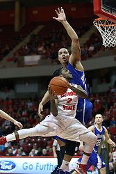 12 January 2013:  Bryant Allen sails in for a shot against defender Jordan Clarke during an NCAA Missouri Valley Conference mens basketball game Where the Bulldogs of Drake University beat the Illinois State Redbirds 82-77 in Redbird Arena, Normal IL