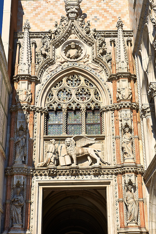 Gothic style Ceremonial entrance, the Porta della Carta ( 1438-1442), on the eastern facade of The Doge's Palace with statues of sculptural portrait of the Doge Francesco Foscari kneeling before the St. Mark's Lion.  , Palazzo Ducale, Venice Italy