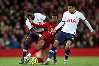 Football - 2019 / 2020 Premier League - Liverpool vs. Tottenham Hotspur<br /> <br /> Moussa Sissoko and Dele Alli of Tottenham Hotspur and Georginio Wijnaldum of Liverpool, at Anfield.<br /> <br /> COLORSPORT/PAUL GREENWOOD