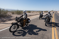 Steve Rinker in the lead with his twin sons Jared and Justin behind, each riding their own 1916 Indians during the Motorcycle Cannonball Race of the Century. Stage-13 ride from Williams, AZ to Lake Havasu CIty, AZ. USA. Friday September 23, 2016. Photography ©2016 Michael Lichter.