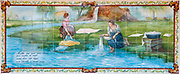 Traditional Portuguese painted tiles (Azulejos) depicting two women doing laundry in a river in Aveiro District, Portugal