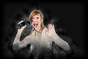 Digitally enhanced image of an excited and happy young woman with binoculars