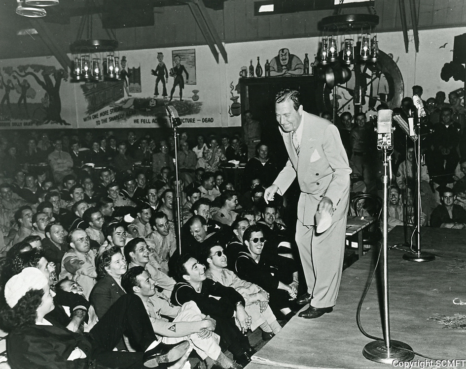 1944 Phil Harris entertains the audience at the Hollywood Canteen.