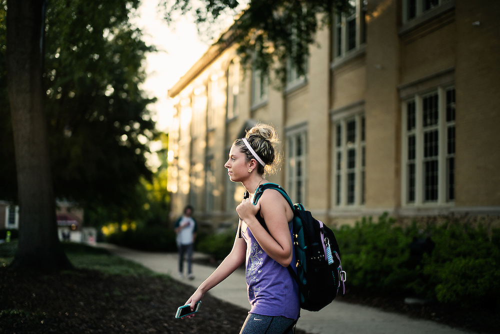 TUSCALOOSA, AL – SEPTEMBER 28, 2016: Megan Kaper from Liberty Township, Ohio walks to her dorm after class at the University of Alabama. Despite the rising cost of college tuition nationwide, in state student enrollment is becoming less profitable for major public universities. In response to these financial shortfalls, flagship universities around the country are working hard to rebrand themselves as attractive institutions for out of state students. The University of Alabama has begun an aggressive campaign to recruit out of state students, as the revenue from those students is much greater. CREDIT: Bob Miller for The New York Times