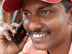 Smiling man talking on mobile phone, Mumbai