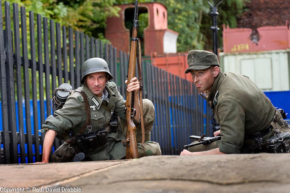 Renactors portraying second world war German troops prepare for a battle reenactment at the  Elsecar 1940s Weekend <br /> 4 September 2010<br /> Images © Paul David Drabble