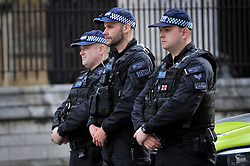 © Licensed to London News Pictures. 12/11/2017. London, UK.  Police stand in silence in Parliament Square as Big Ben chimes specially on Remembrance Sunday where members of the Royal Family, dignatories and veterans gave tributes to war dead at The Cenotaph.  Photo credit: Stephen Chung/LNP