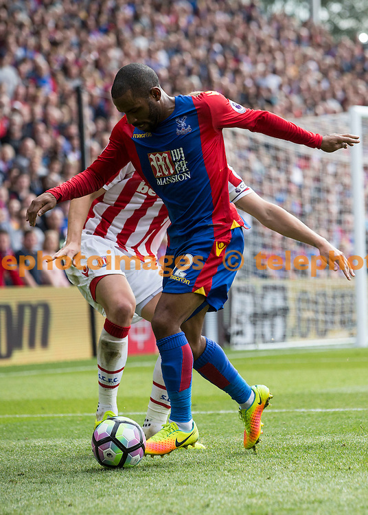 Jason Puncheon fends off a defender during the Premier League match between Crystal Palace and Stoke City at Selhurst Park in London. September 18, 2016.<br /> Jack Beard / Telephoto Images<br /> +44 7967 642437
