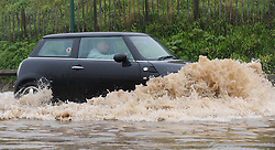 © Licensed to London News Pictures. 30/05/2013<br /> <br /> Saltburn, Cleveland, United Kingdom<br /> <br /> The driver of a mini makes his way through deep water as heavy overnight rain causes flooding in Saltburn on the A174 coast road near to the Ship Inn on the seafront in the town.<br /> <br /> Photo credit : Ian Forsyth/LNP