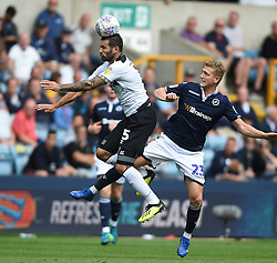 Millwall's George Saville and Derby County's Bradley Johnson battle for the ball