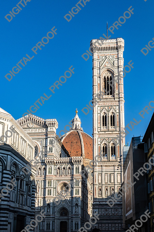 Firenze, Tuscany Italy - December 30, 2018 Giotto's Bell Tower with Florence Dome and Baptistery of Saint John's at the background