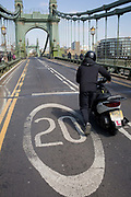 After being closed indefinitely to all traffic due to structural faults, a motorcyclist walks his bike across Hammersmith Bridge, on 11th April 2019, in west London, England. Safety checks revealed critical faults and Hammersmith and Fulham Council has said its ben left with no choice but to shut the bridge until refurbishment costs could be met. The government has said that between 2015 and 2021 its is providing £11bn of support to the 132-year-old bridge.