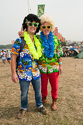© Licensed to London News Pictures. 06/09/2014. Isle of Wight, UK. Festival goers at Bestival 2014 Day 3 Saturday in fancy dress costume.  Today is the festival's Fancy Dress Day - this year the theme is Desert Island Disco.  Festival goers spend the morning readying their costumes before the judging of the competition at 2pm.  This weekend's headliners include Chic featuring Nile Rodgers, Foals and Outcast.   Bestival is a four-day music festival held at the Robin Hill country park on the Isle of Wight, England. It has been held annually in late summer since 2004.    Photo credit : Richard Isaac/LNP