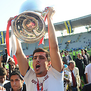 Jubilant Trabzonspor players lifting up the cup at the ceremony during their after the Turkey Cup final match Trabzonspor between Fenerbahce at the GAP Arena Stadium at Urfa Turkey on wednesday, 05 May 2010. Photo by TURKPIX