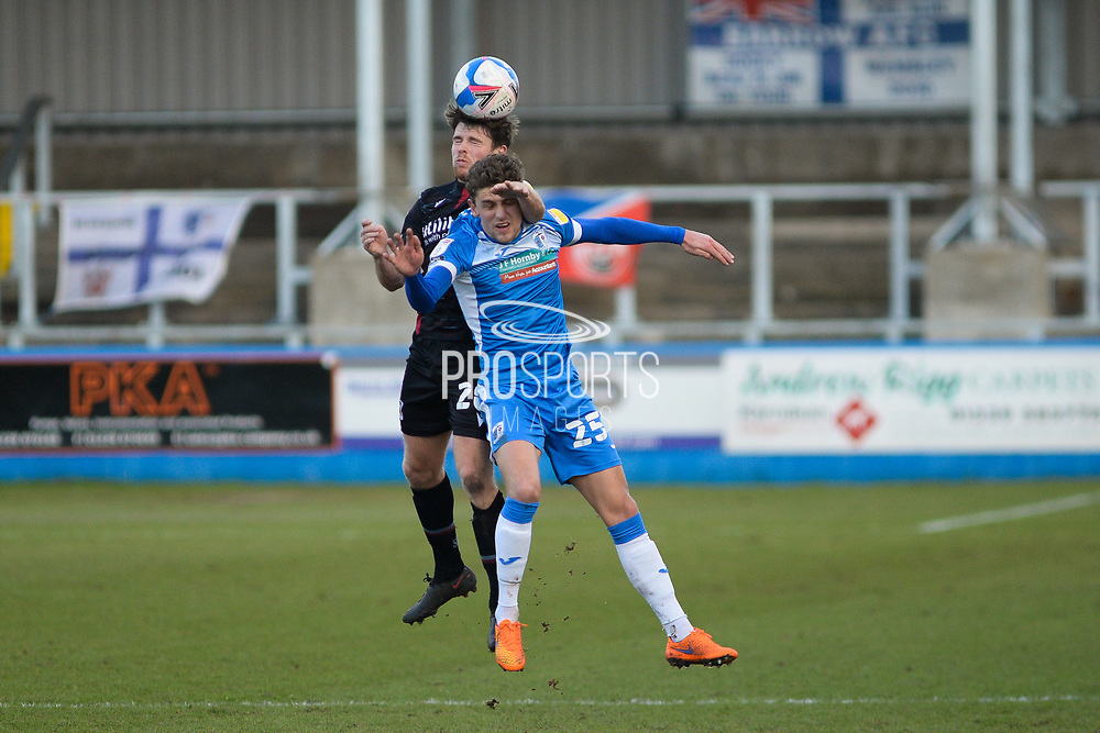 Scunthorpe United Lewis Spence (20) Barrow Harrison Biggins (25) battles for possession during the EFL Sky Bet League 2 match between Barrow and Scunthorpe United at Progression Solicitors Stadium, Barrow, United Kingdom on 16 January 2021.