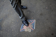 A passer-by stamps on a poster of Egyptian president Mohammed Morsi outside the presidential palace in Cairo, Egypt