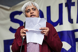 Southall, UK. 27th April 2019. Pragna Patel of Southall Black Sisters addresses members of the local community and supporters at a rally outside Southall Town Hall to honour the memories of Gurdip Singh Chaggar and Blair Peach on the 40th anniversary of their deaths. Gurdip Singh Chaggar, a young Asian boy, was the victim of a racially motivated attack whilst Blair Peach, a teacher, was killed by the Metropolitan Police's Special Patrol Group during a peaceful march against a National Front demonstration.
